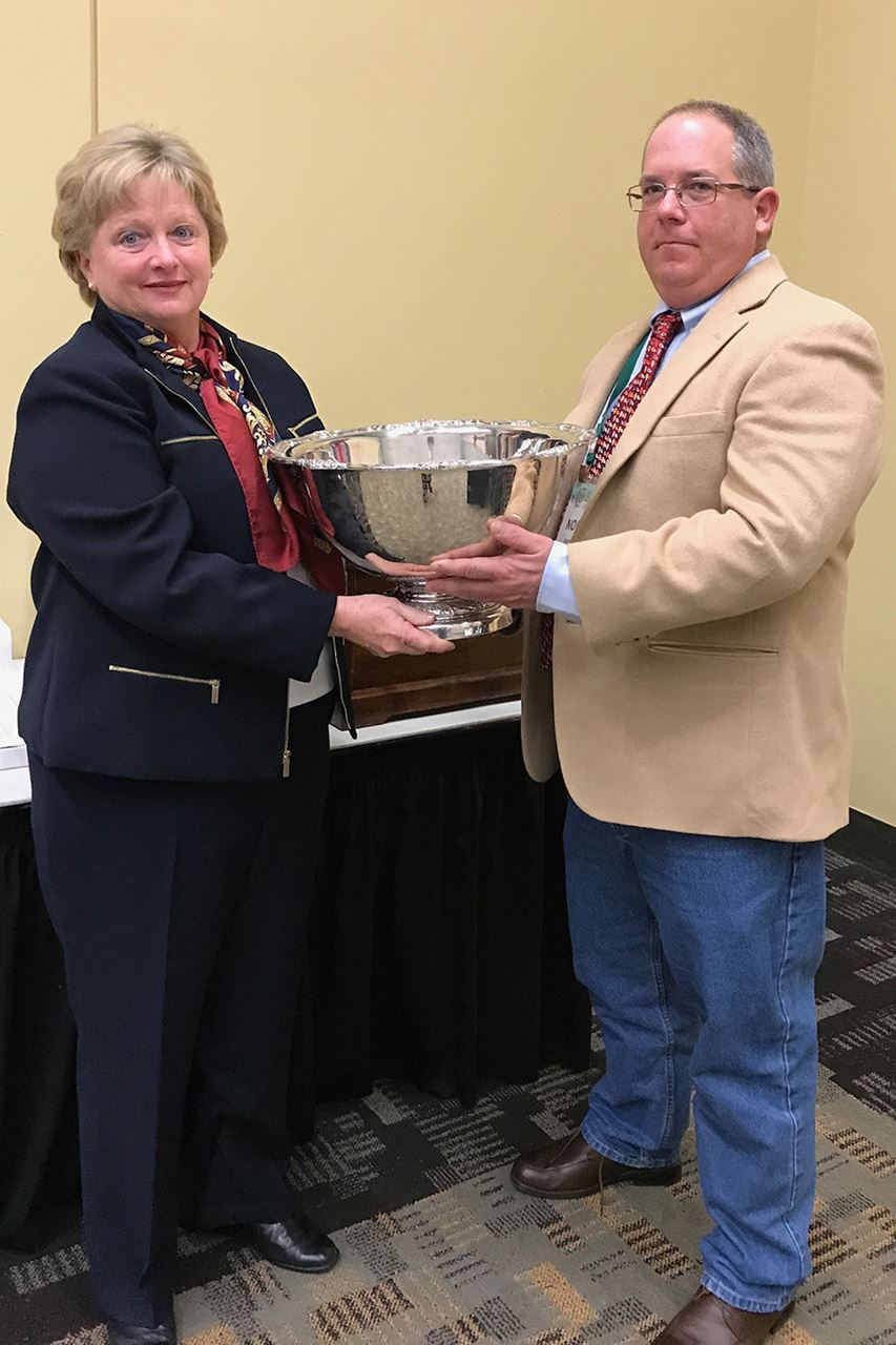 SNA President Norman Cole presents the Slater Wight Memorial Award to Dr. Donna Fare